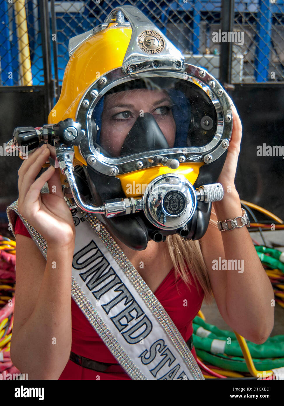 Lt. Corinne Devin, Miss United States 2012, tries on dive equipment during a tour of the Mobile Diving and Salvage - Stock Image