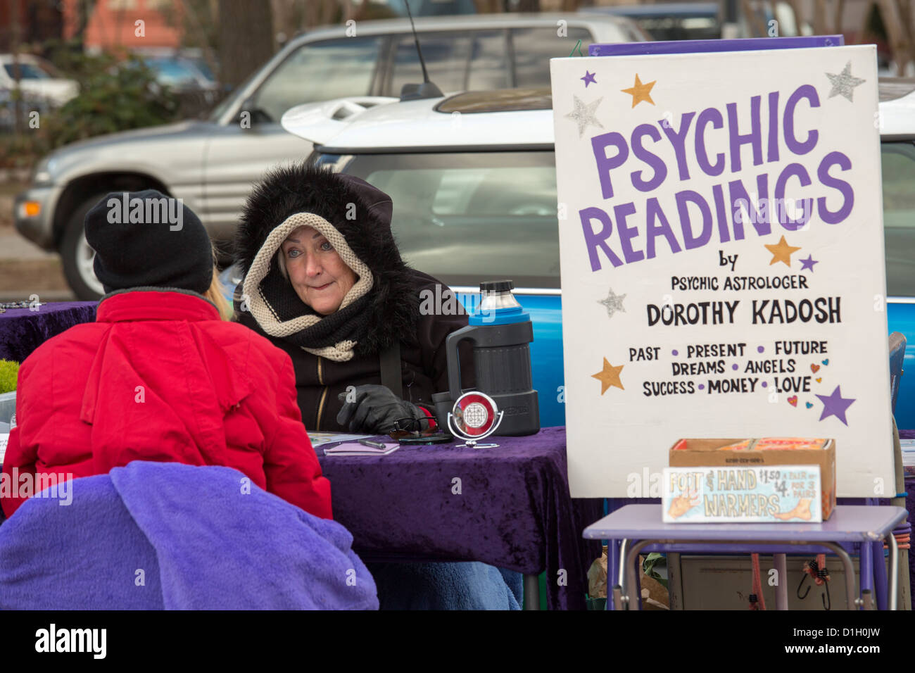 Washington, DC - A woman gives psychic readings on a street corner in the Eastern Market neighborhood. - Stock Image