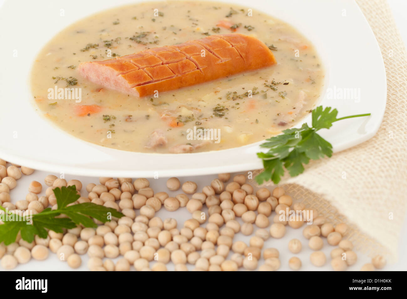 Polish soup with dry pea on white background - Stock Image