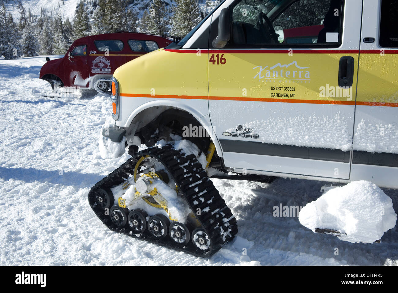 Converted van for carrying winter visitors over the snow covered road in Yellowstone National Park at Norris Geyser - Stock Image