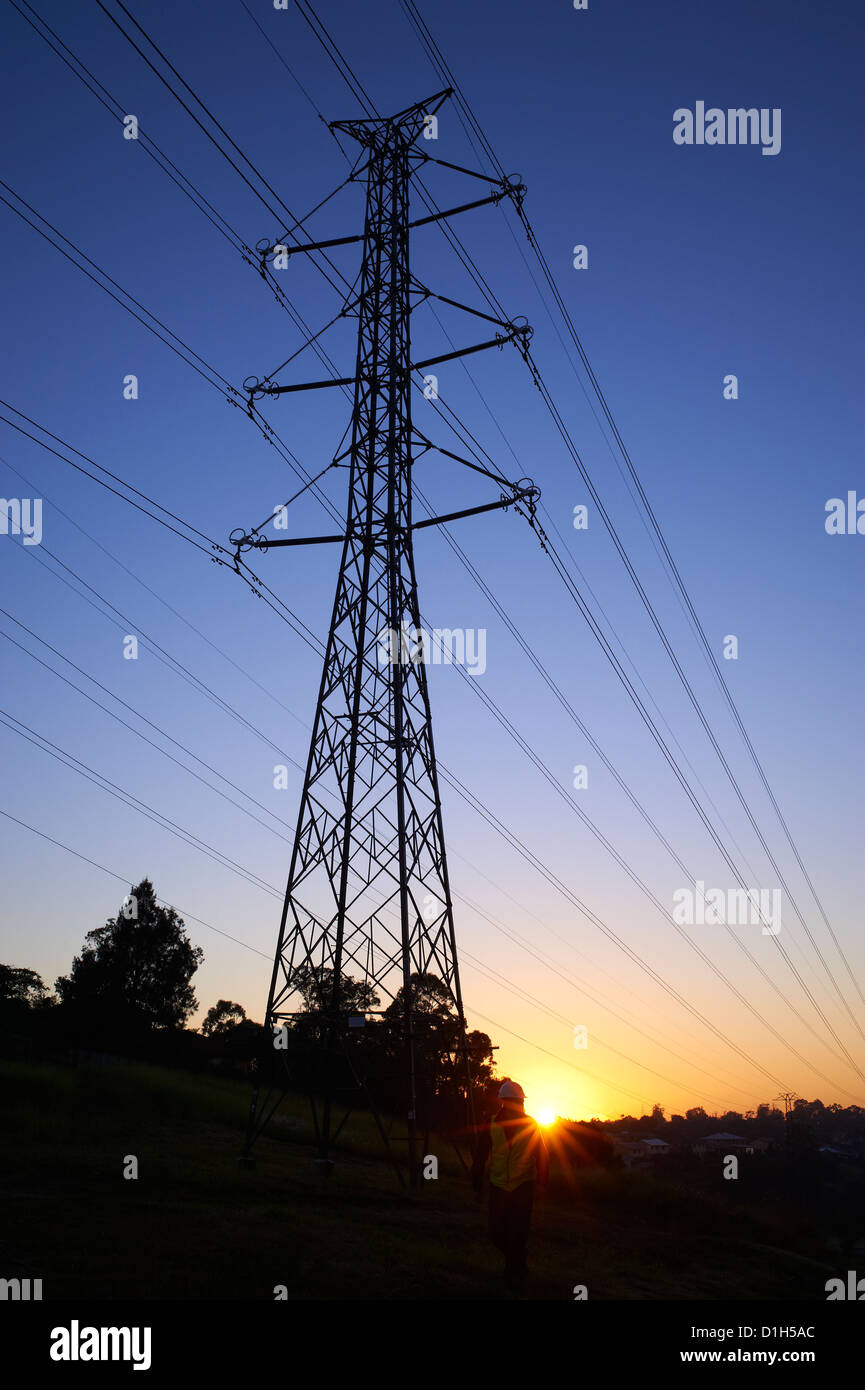 Silhouetted high voltage electricity pylon Stock Photo