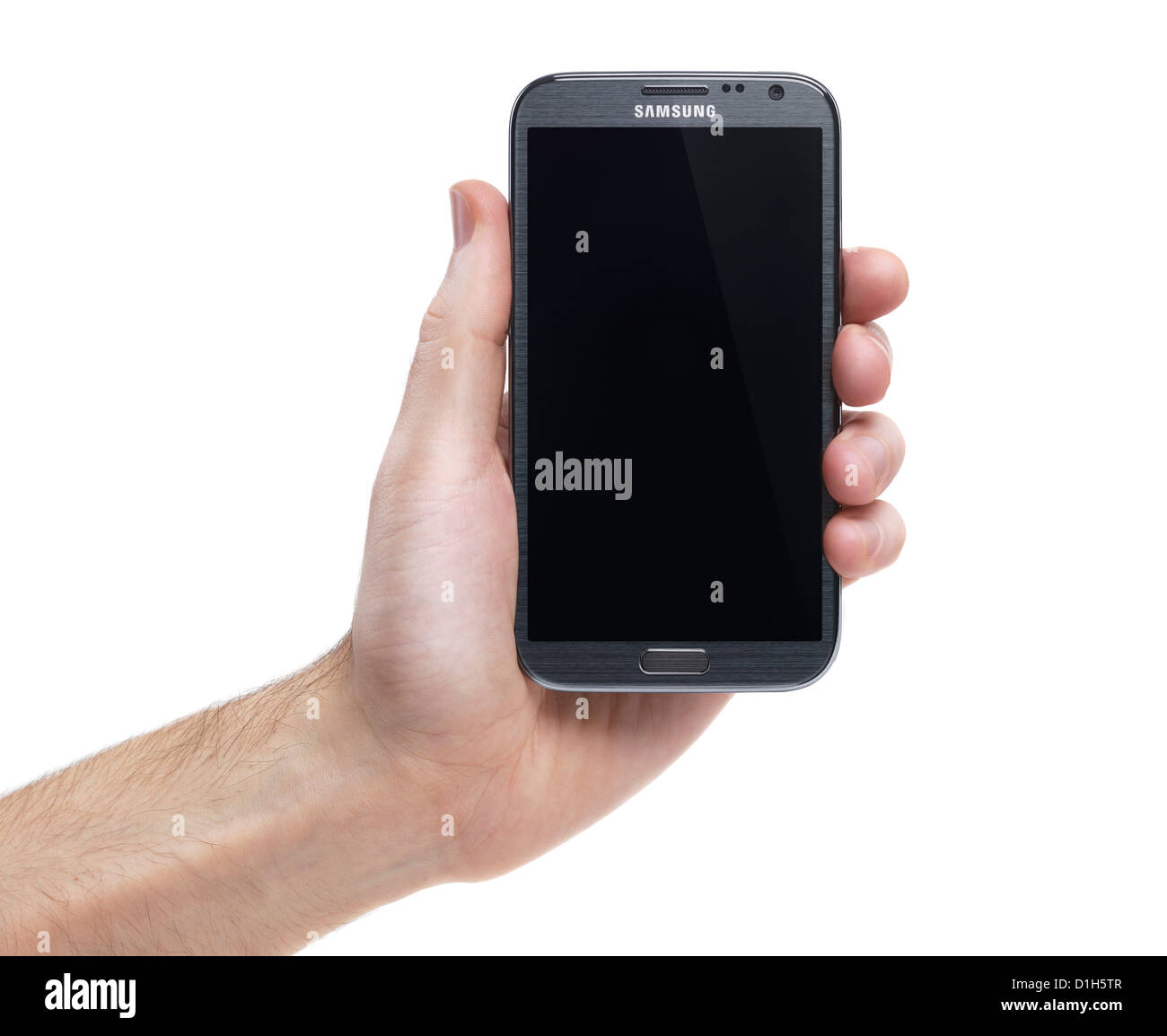 Hand holding Samsung Galaxy Note II smartphone Android phone