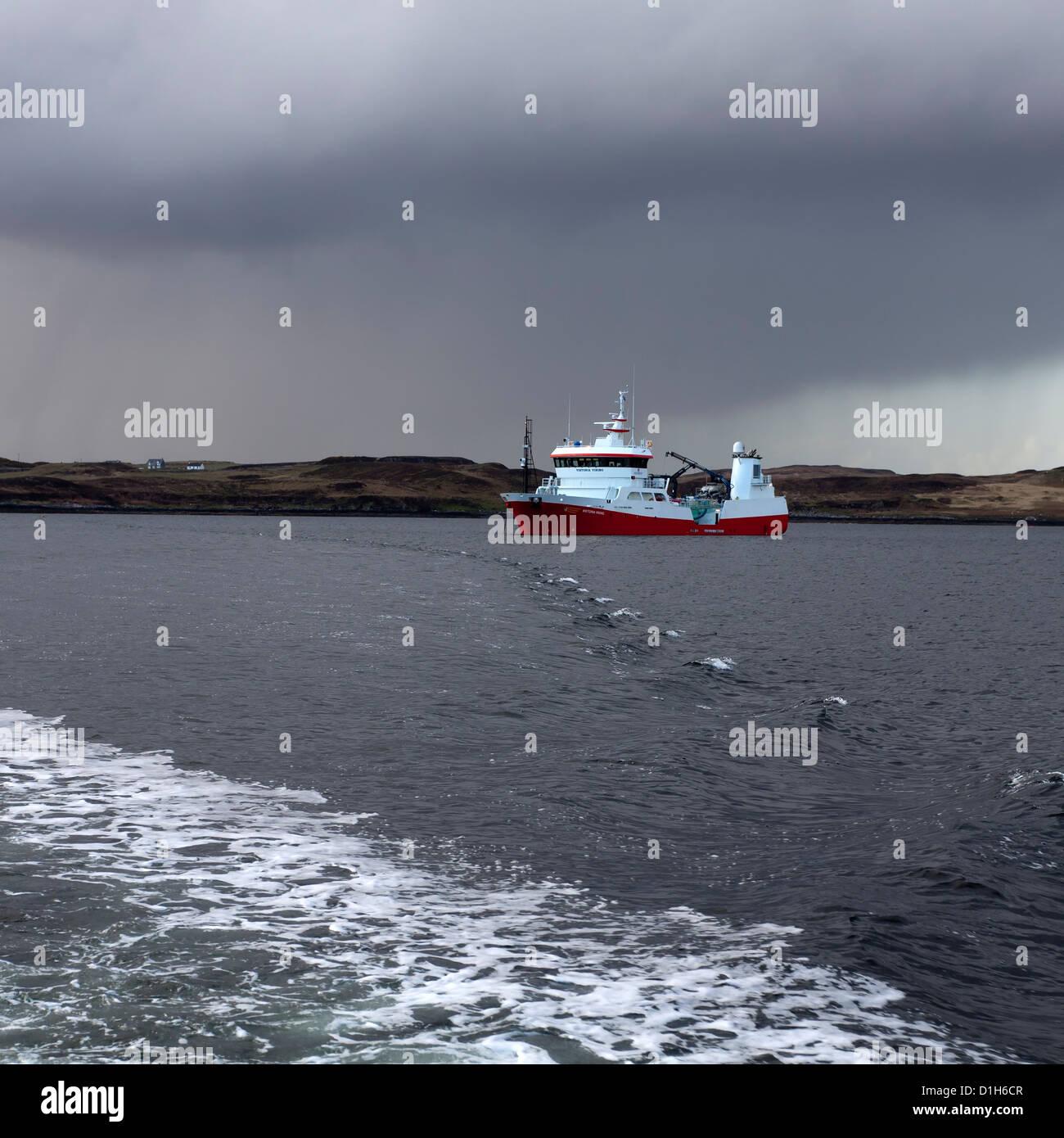 Fish Farming Well boat, Portnalong, Loch Harport, Isle of Skye, Scotland, UK Stock Photo