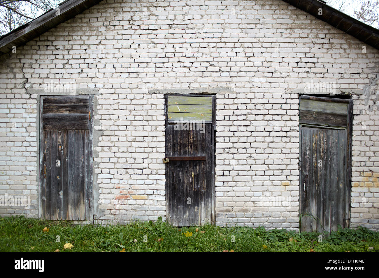 Three doors in the old garage. - Stock Image