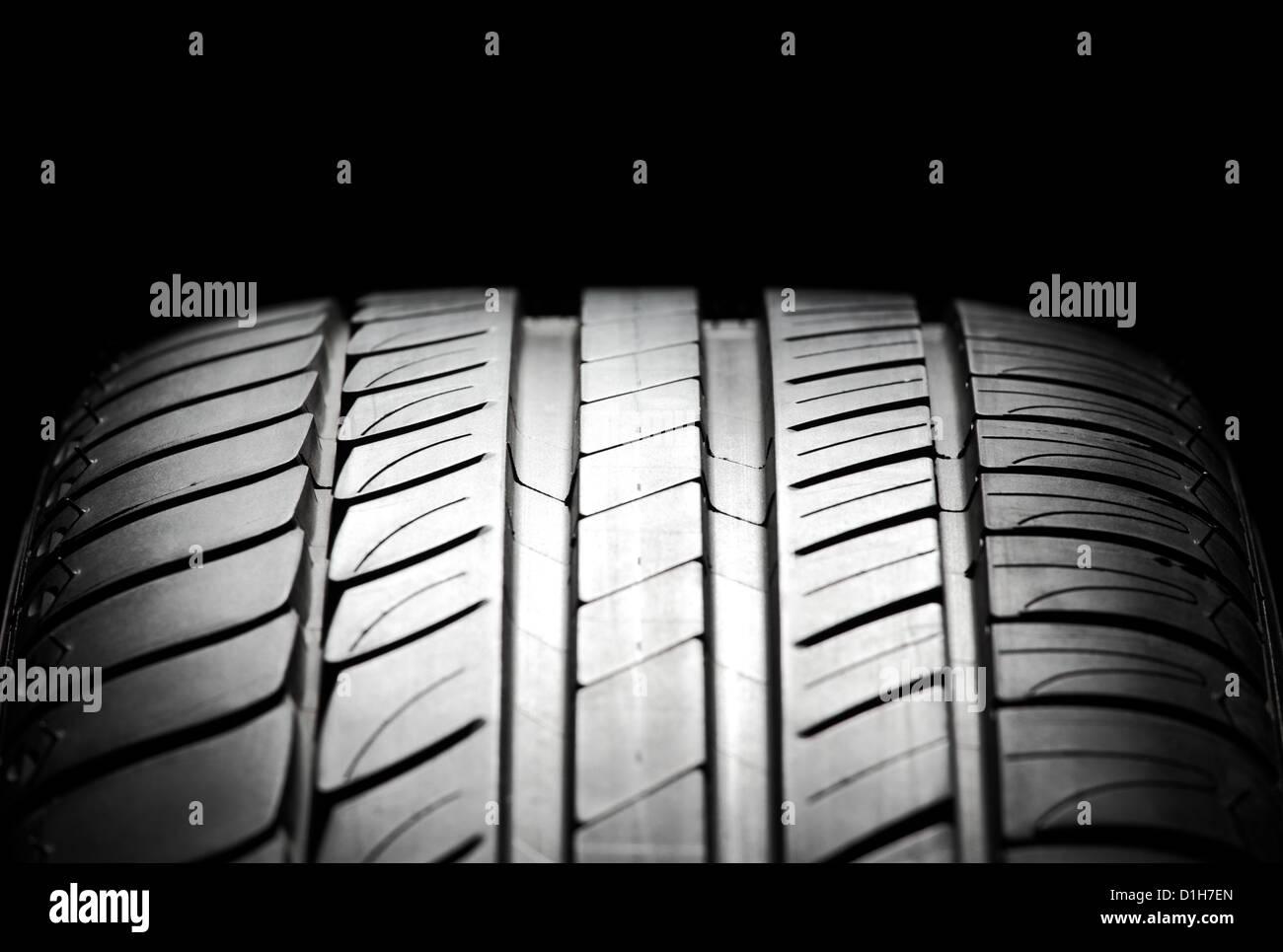High-performance summer tire for sport cars. Studio shot. - Stock Image