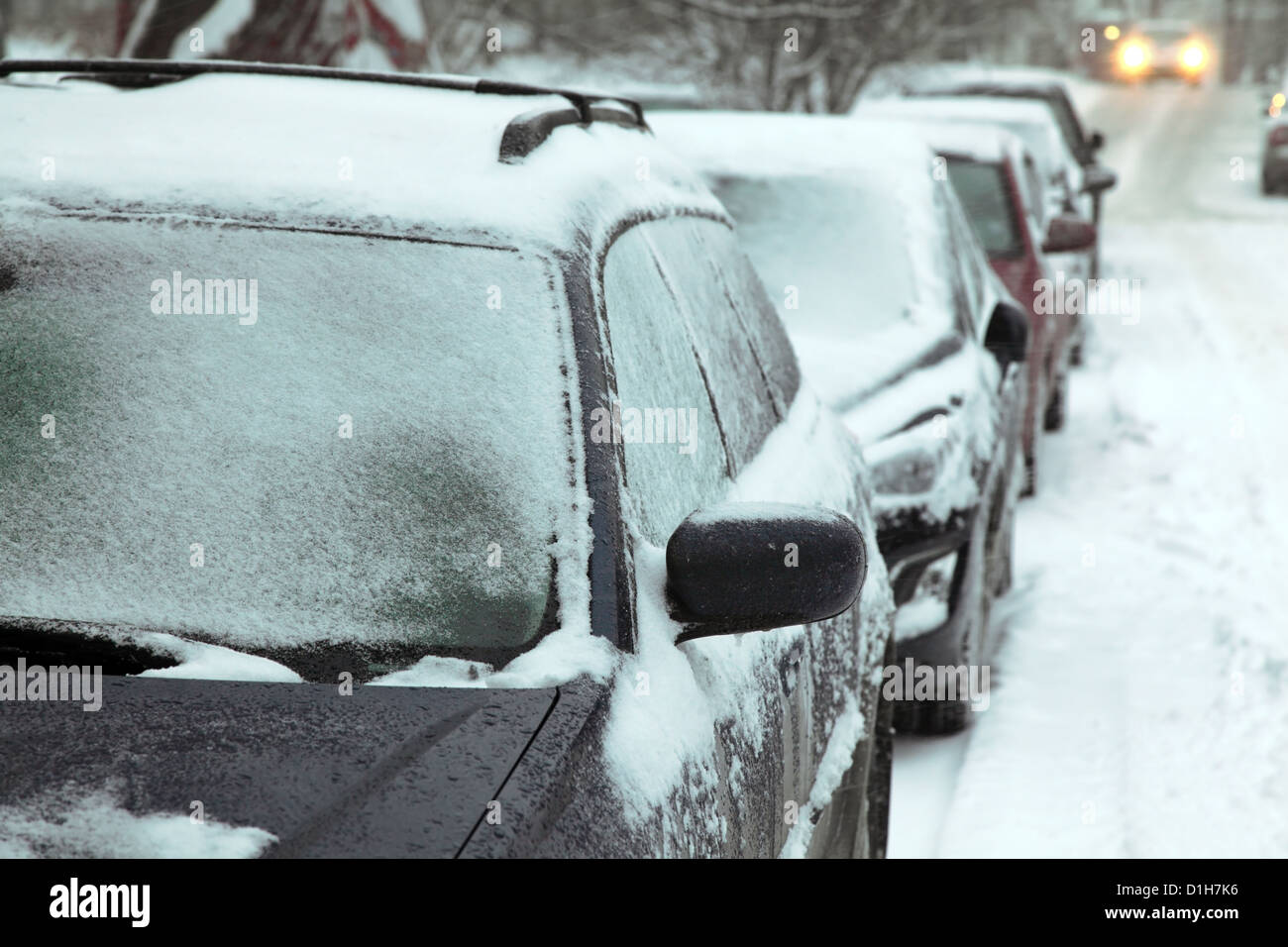 European winter. Snow covered cars. - Stock Image