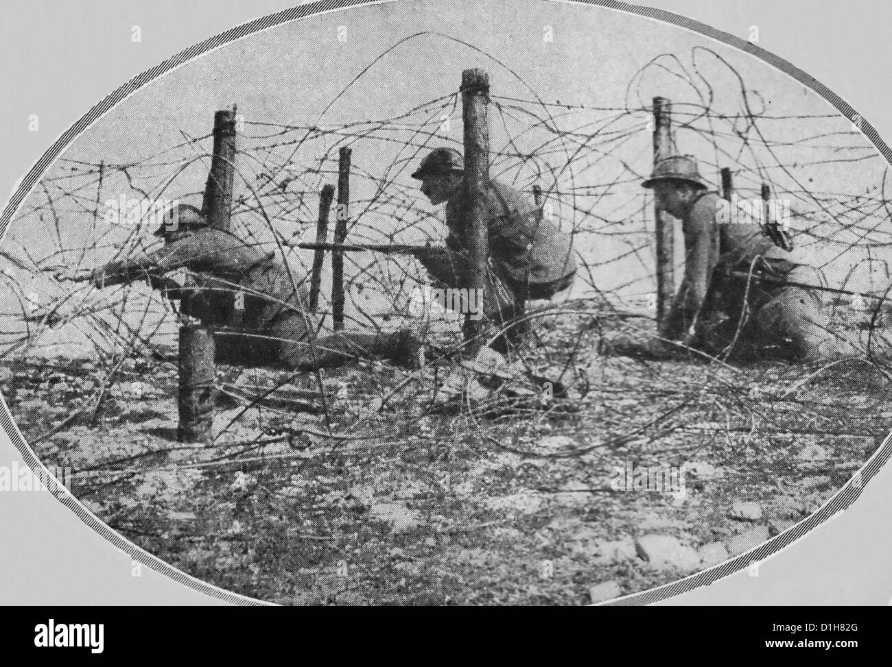 Working through barbed wire - French scouts advancing through enemy entanglements during World War I, 1917 - Stock Image