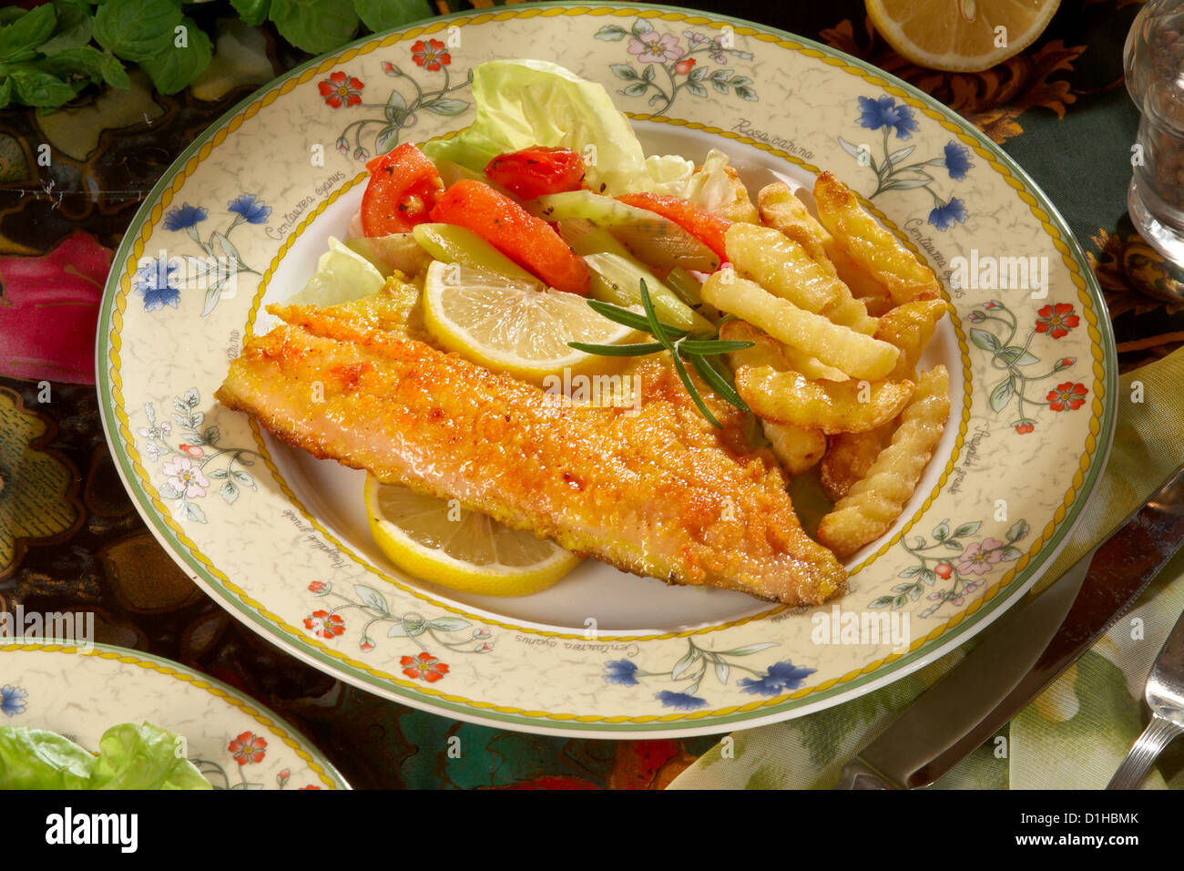 Fish baked with herbs - Stock Image