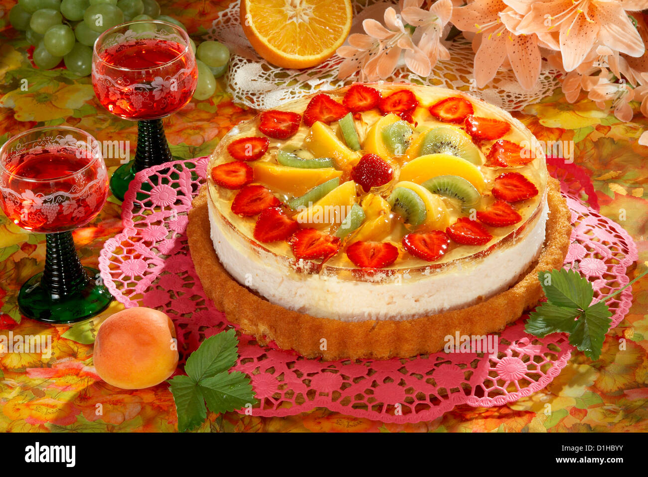 Cheese cake with fruits - Stock Image