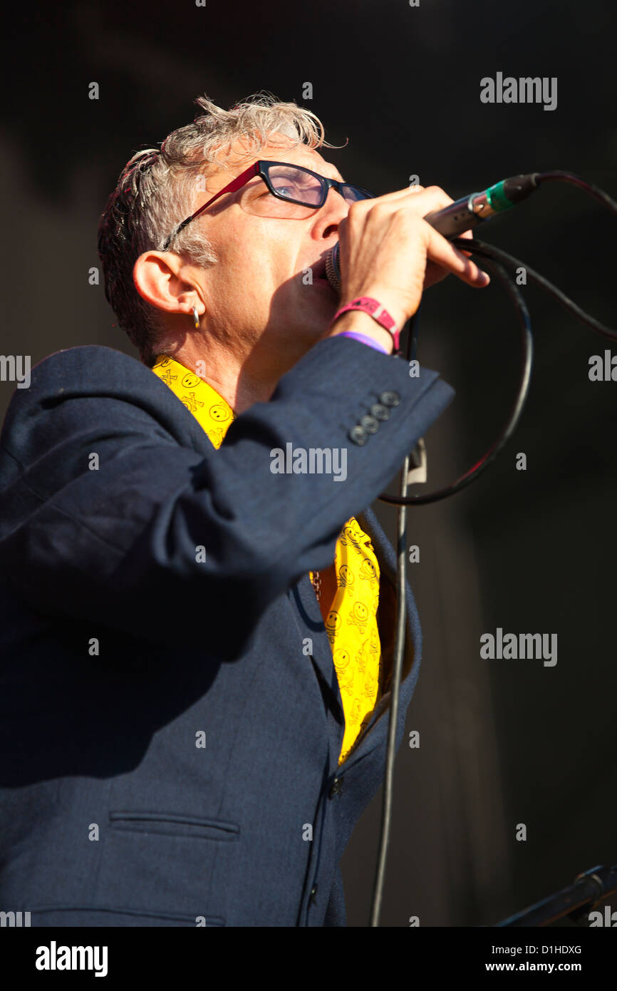 Lead singer Larry Love (Rob Spragg) performs live with band Alabama 3 at Beautiful Days 2012, Escott Park, Devon, - Stock Image