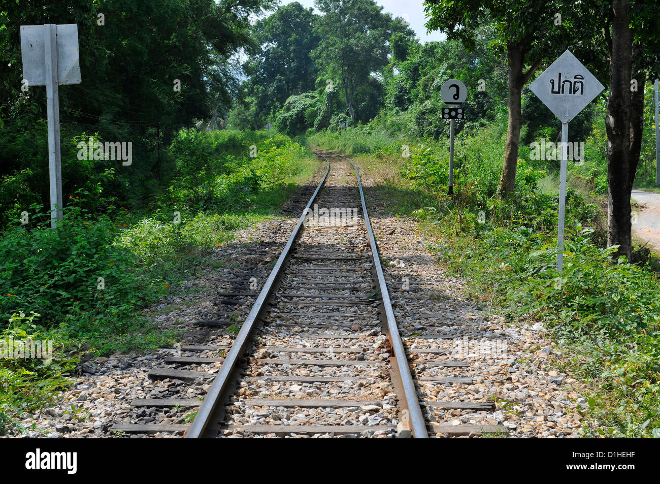 The Burma railway line running north after leaving the Bridge over The River Kwai - Stock Image