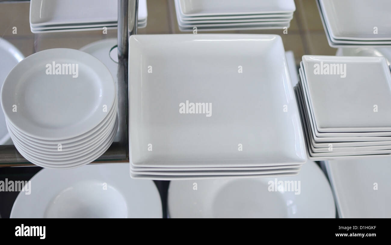 white plates in a shop - Stock Image