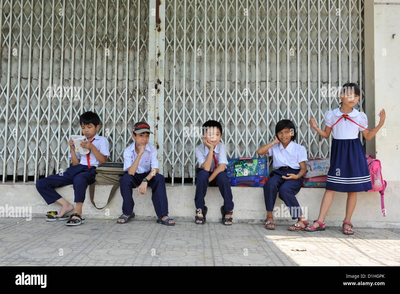 five kids after school in Nha Trang,Vietnam - Stock Image