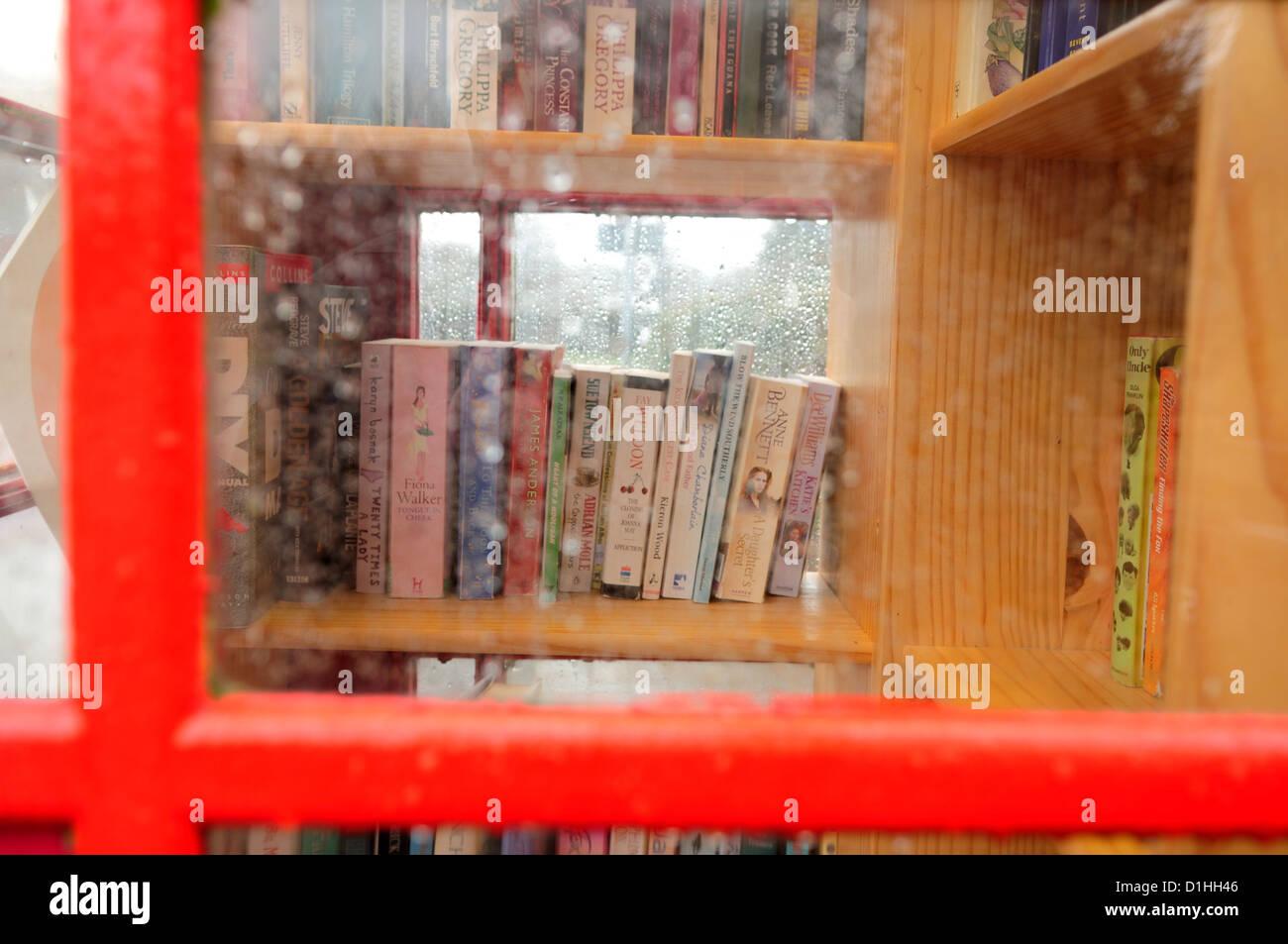 Red Telephone Box,Book Exchange .Hoveringham Nottinghamshire. - Stock Image