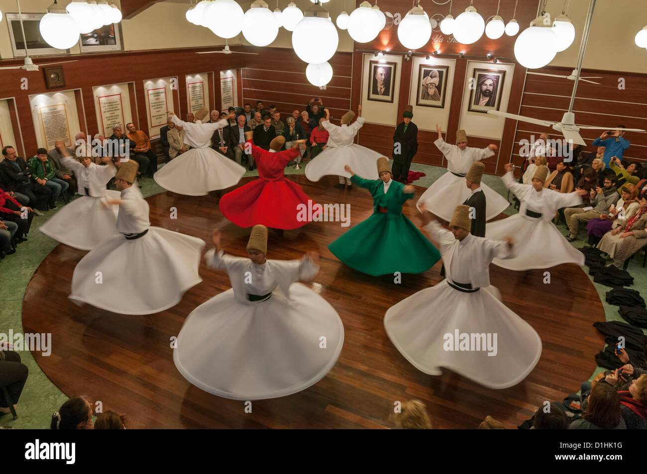 Whirling Dervishes perform in the  Mevlevihane,istanbul,Turkey - Stock Image