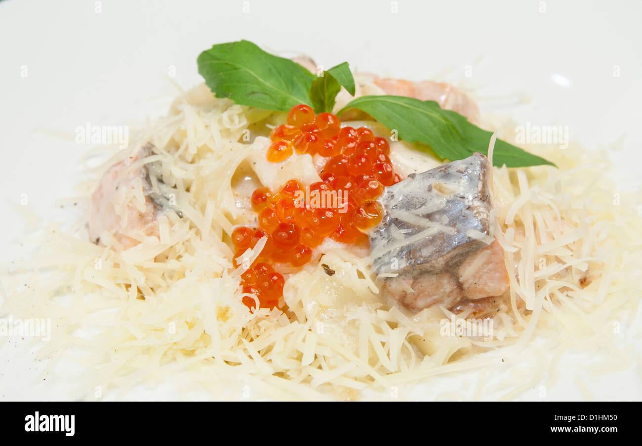 spaghetti with caviar and seafood - Stock Image