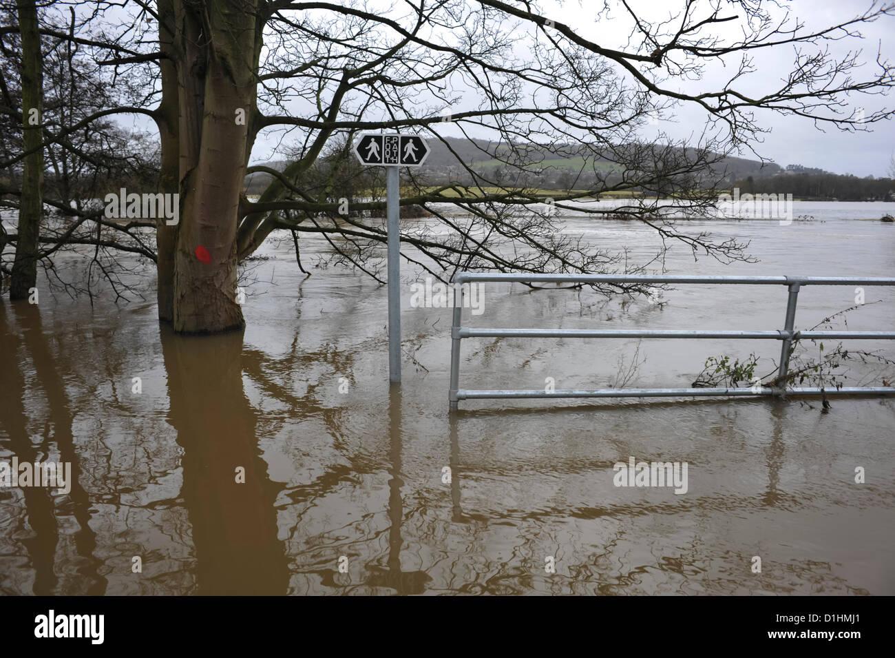 Batheaston,UK. 23rd Dec, 2012. Flooding of the River Avon at Batheaston near Bath renders a riverside footpath unusable Stock Photo