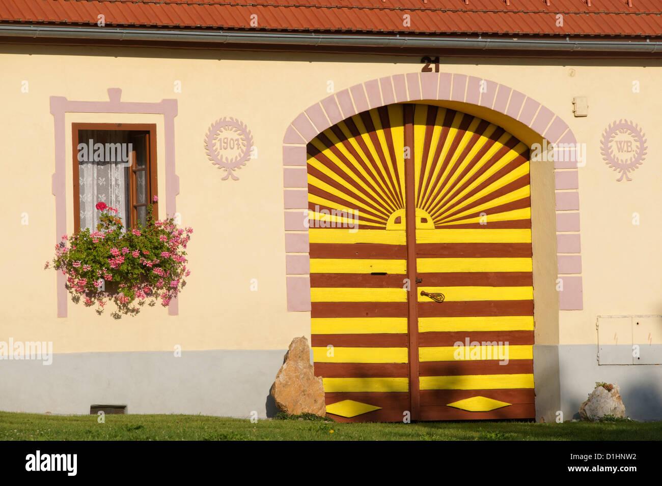 Farmstead gate in Holasovice, South Bohemia, Czech Republic - Stock Image