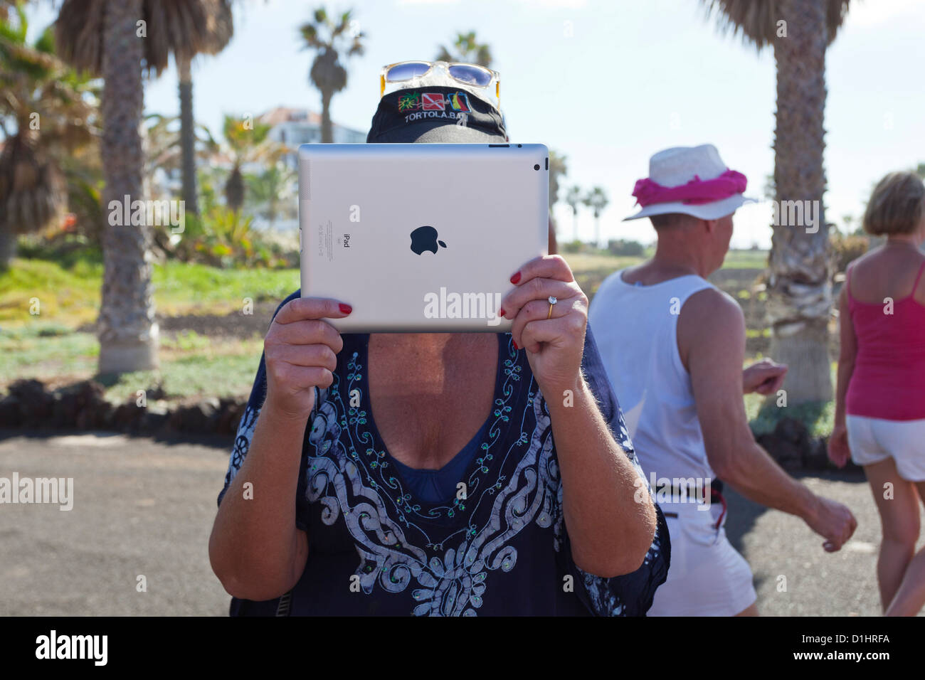 Lady filming with iPad. - Stock Image