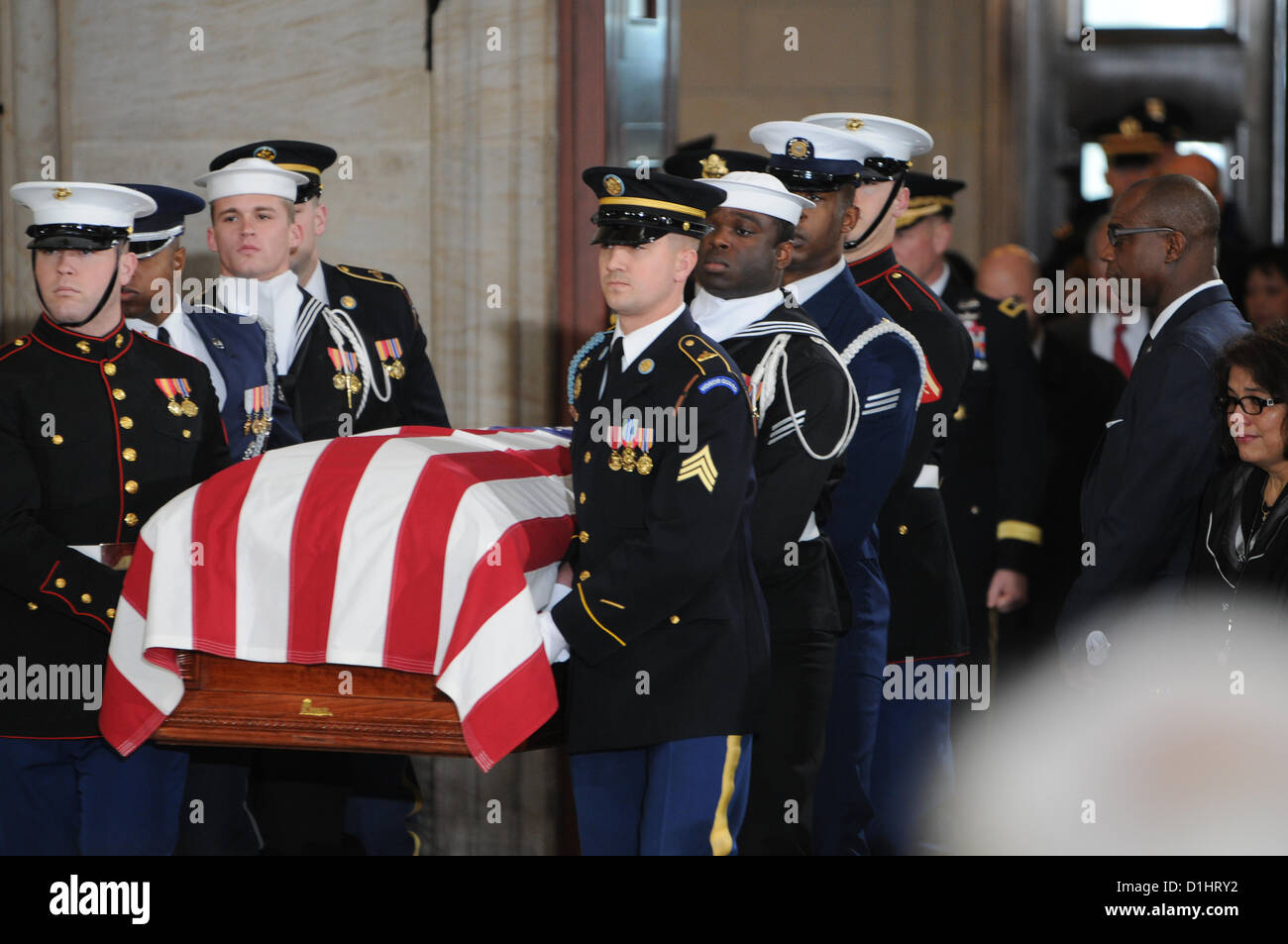 Military honor guards remove the casket of Senator Daniel Inouye after lying in state in the Rotunda of the US Capitol - Stock Image