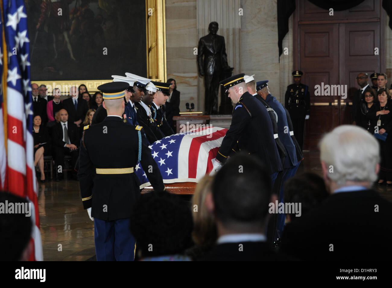 Military honor guards prepare to remove the casket of Senator Daniel Inouye lying in state in the Rotunda of the - Stock Image