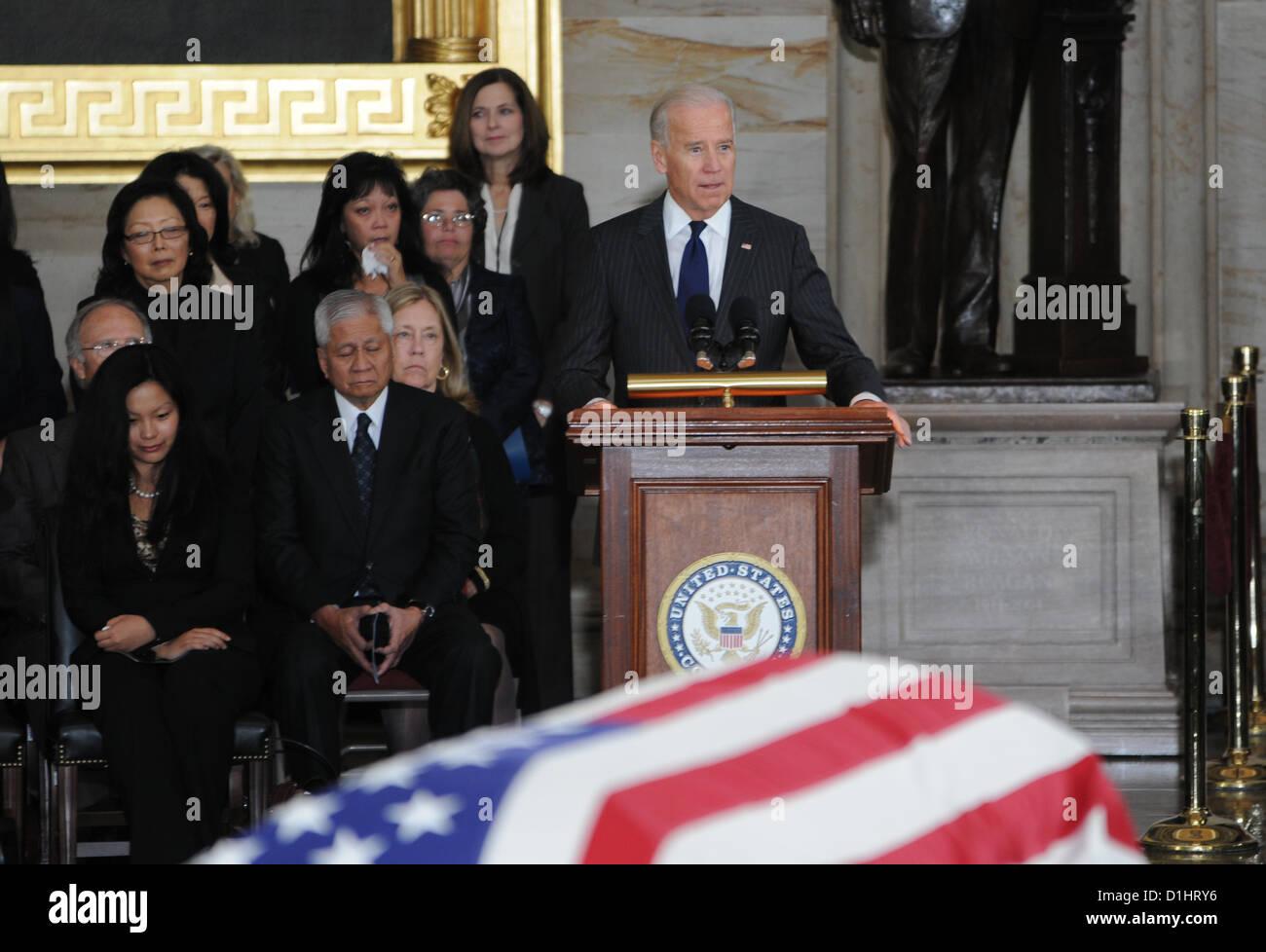 Vice President Joe Biden pays his respect to Senator Daniel Inouye lying in state in the Rotunda of the US Capitol Stock Photo