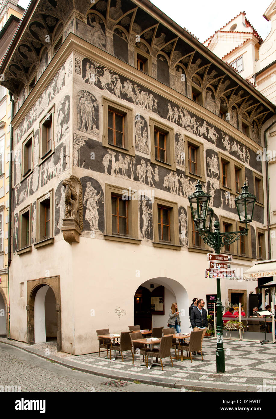 'House at the Minute', a renaissance building featuring architectural sgraffito on Old Town Square in Prague. - Stock Image