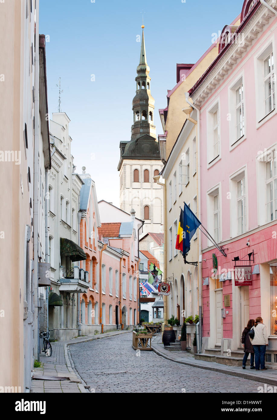 View of St. Nicholas' Church steeple from a street in the old town in Tallinn, the capital of Estonia. - Stock Image