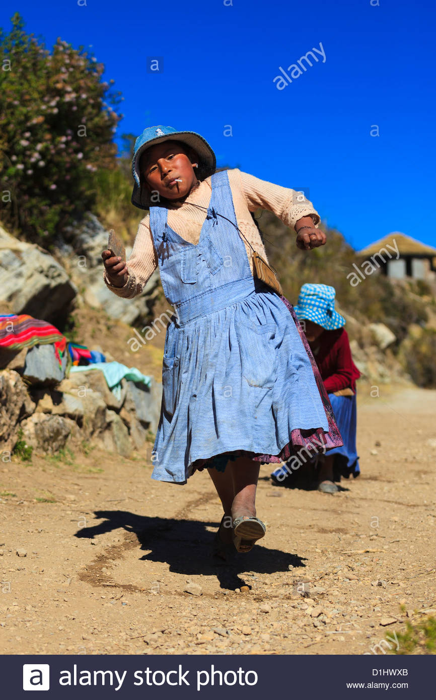 Girl playing on Isla del Sol on the Bolivian Side of Lake Titicaca, Bolivia Stock Photo