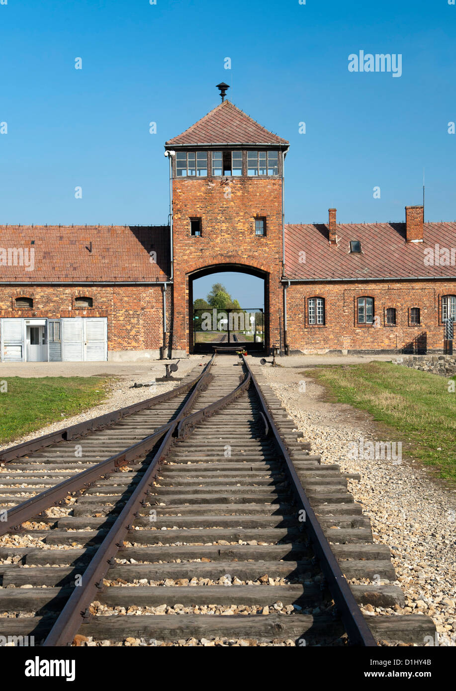 Entrance building and railway line of the former Auschwitz II–Birkenau concentration camp in southern Poland. - Stock Image
