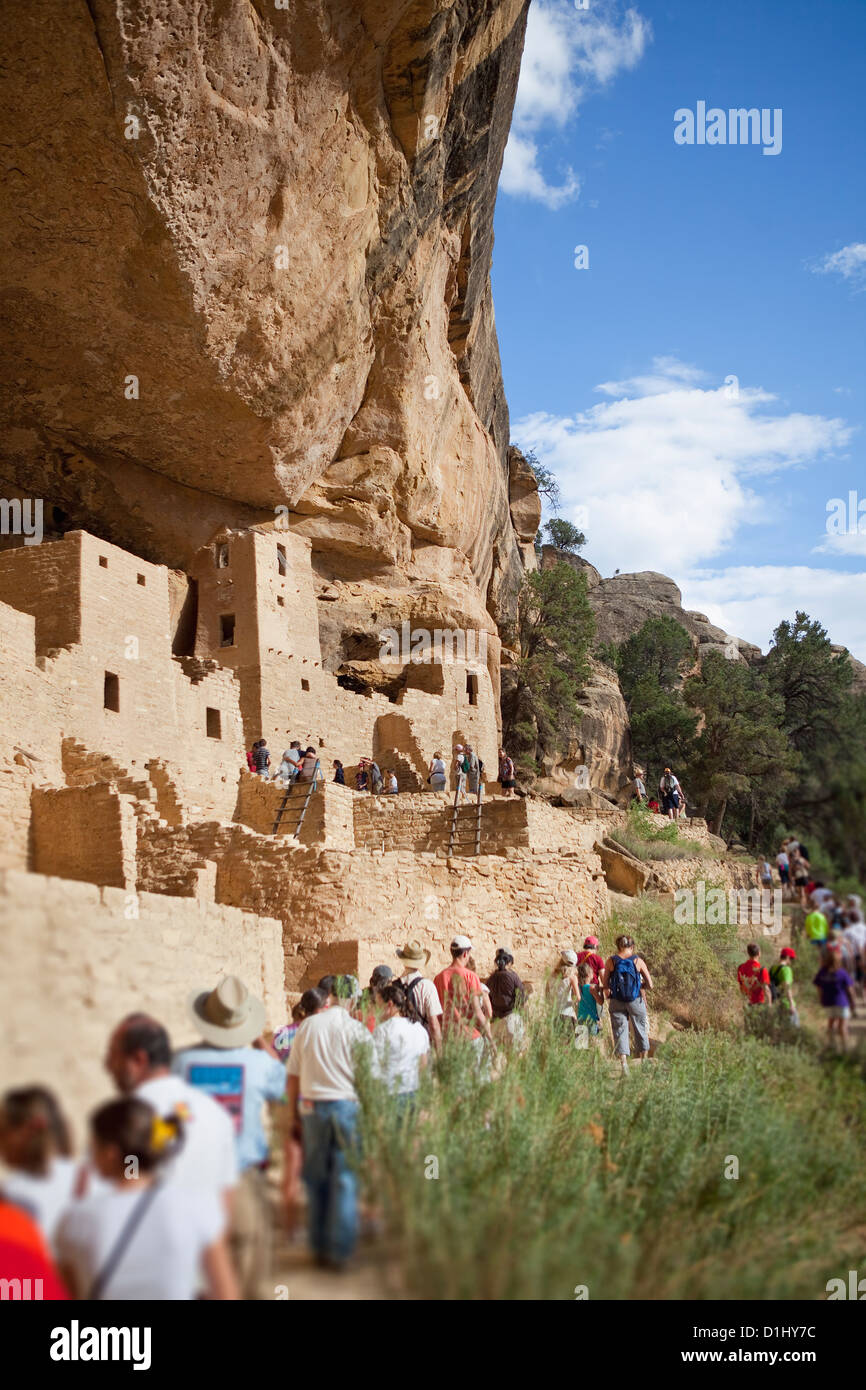 Tourists visit Cliff Palace cliff dwellings in Mesa Verde National Park, Colorado - Stock Image