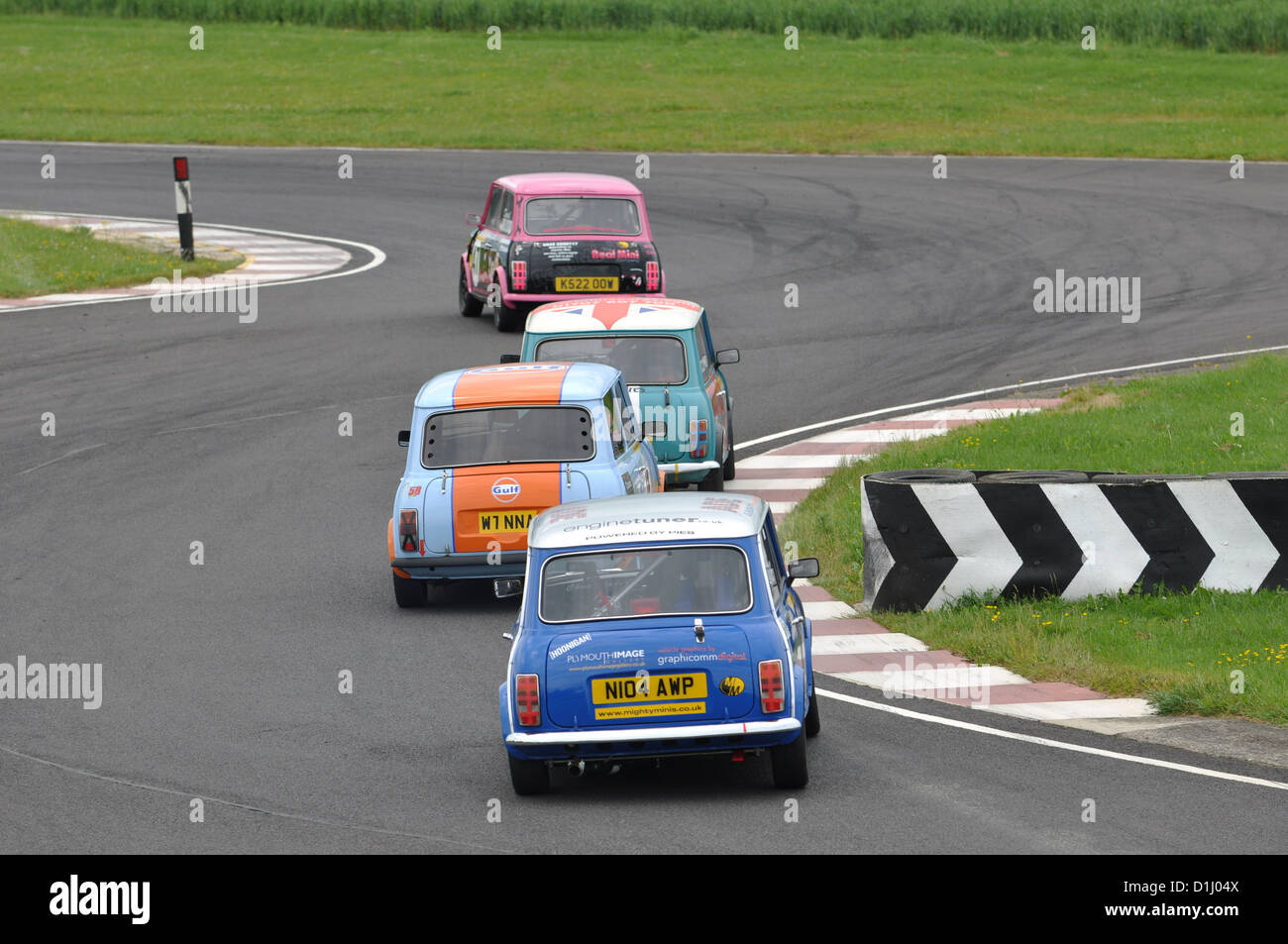 Classic Minis racing at Castle Combe Circuit - Stock Image