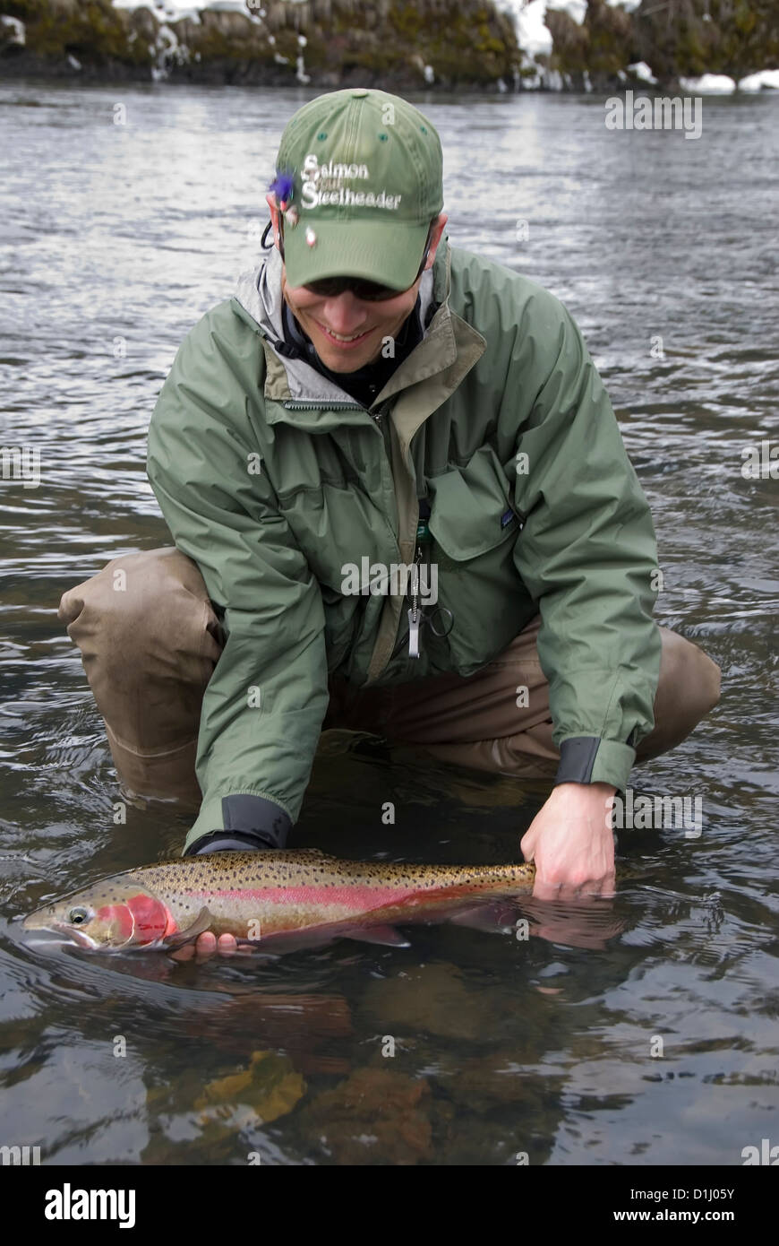 Successful fisherman with a steelhead trout, Grande Ronde River, Oregon. - Stock Image