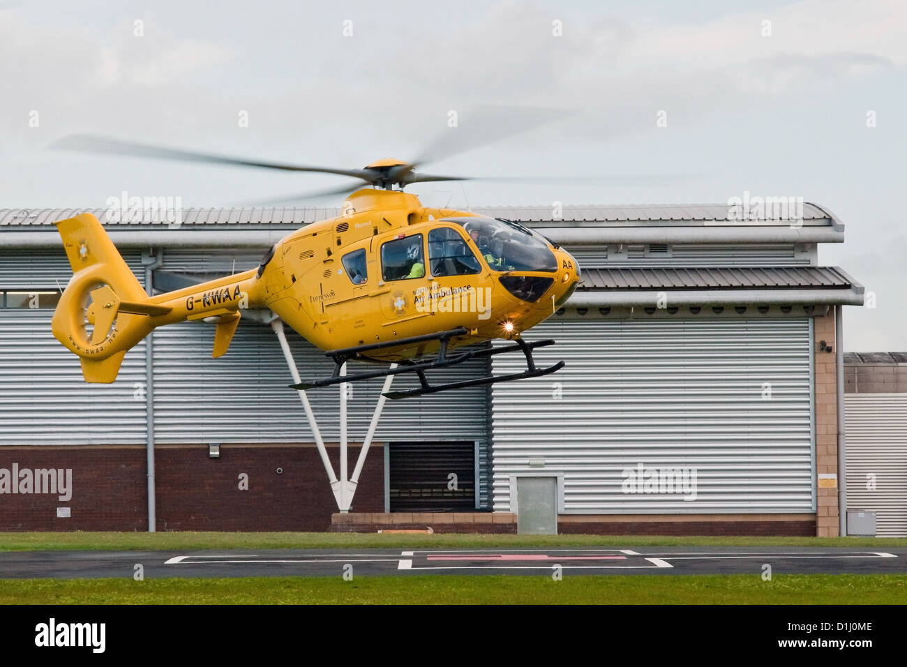 North West Air Ambulance helicopter lifts off from the heli-pad at Royal Preston Hospital, Lancashire - Stock Image