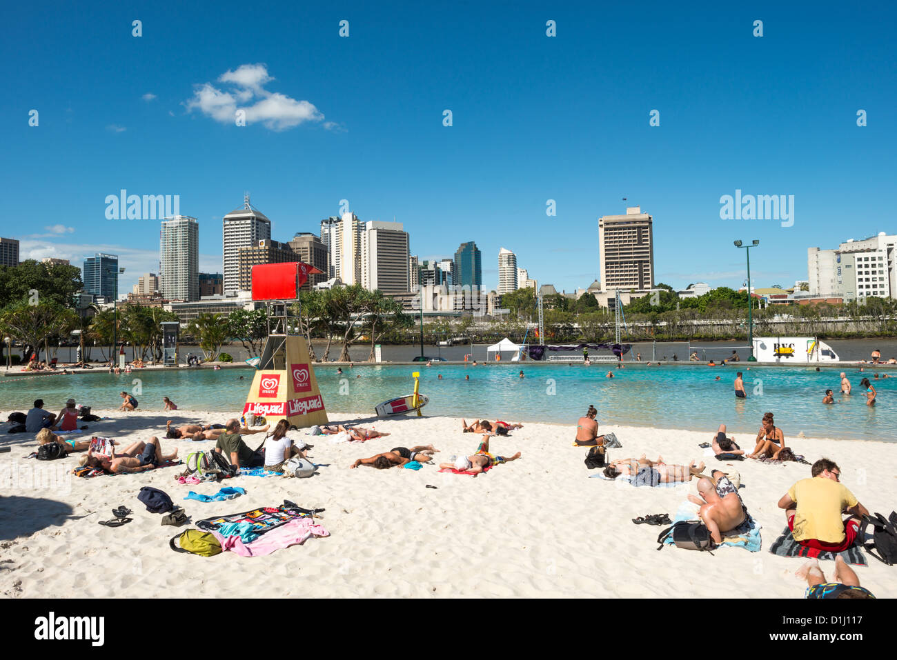 The artificial beach at South Bank across the Brisbane River from the CBD of Brisbane, the Queensland capital. - Stock Image