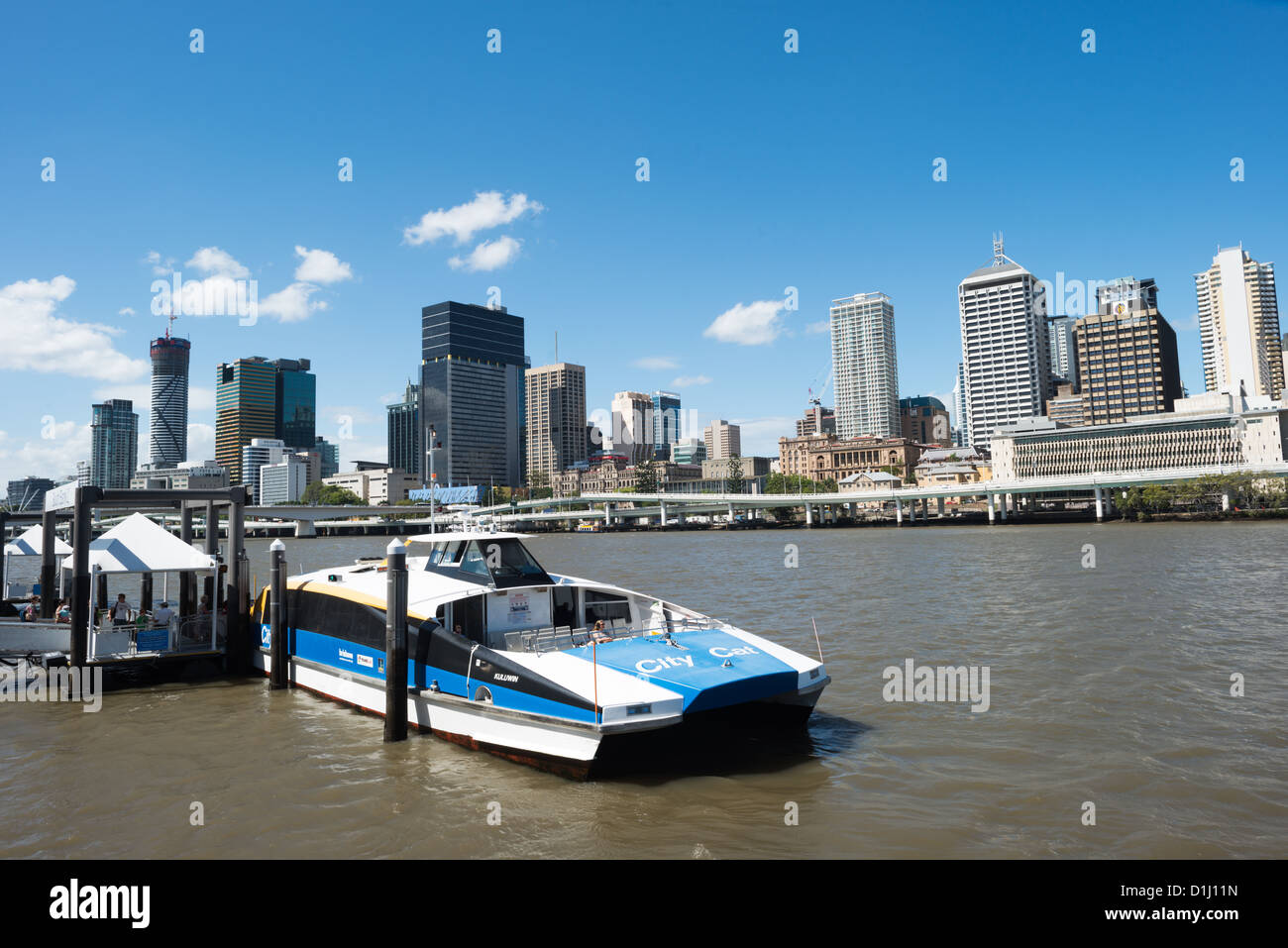 BRISBANE, Australia - A Citycat ferry pulled up to a ferry terminal at South Bank, with the Brisbane city skyline Stock Photo