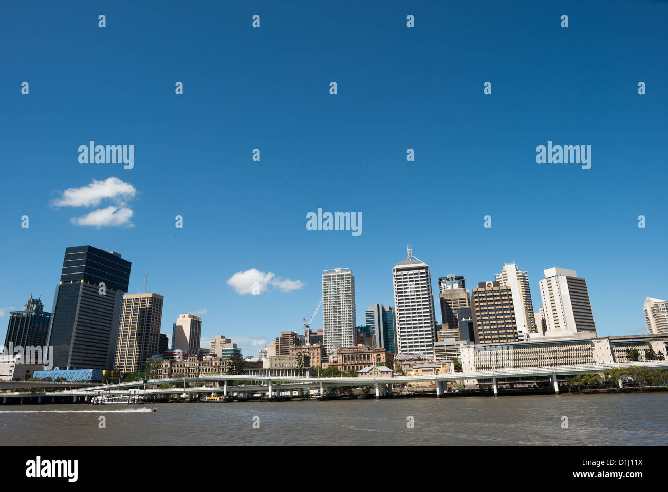 BRISBANE, Australia - Brisbane city skyline from across the Brisbane River at South Bank on a clear sunny summer's - Stock Image
