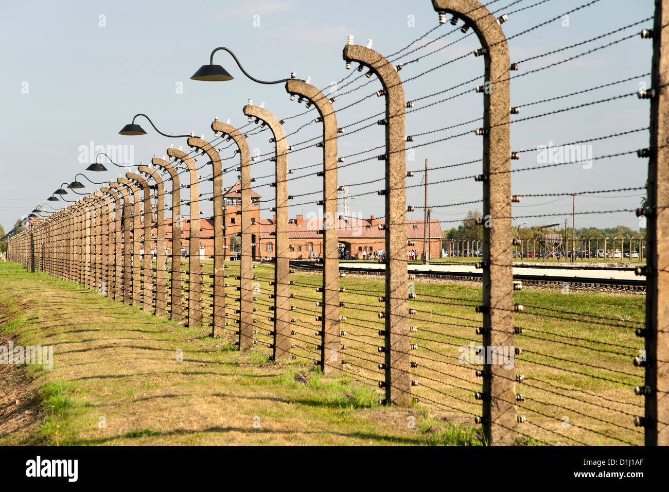 Electrified, barbed-wire fencing at the museum of the former Auschwitz II–Birkenau concentration camp in southern Stock Photo