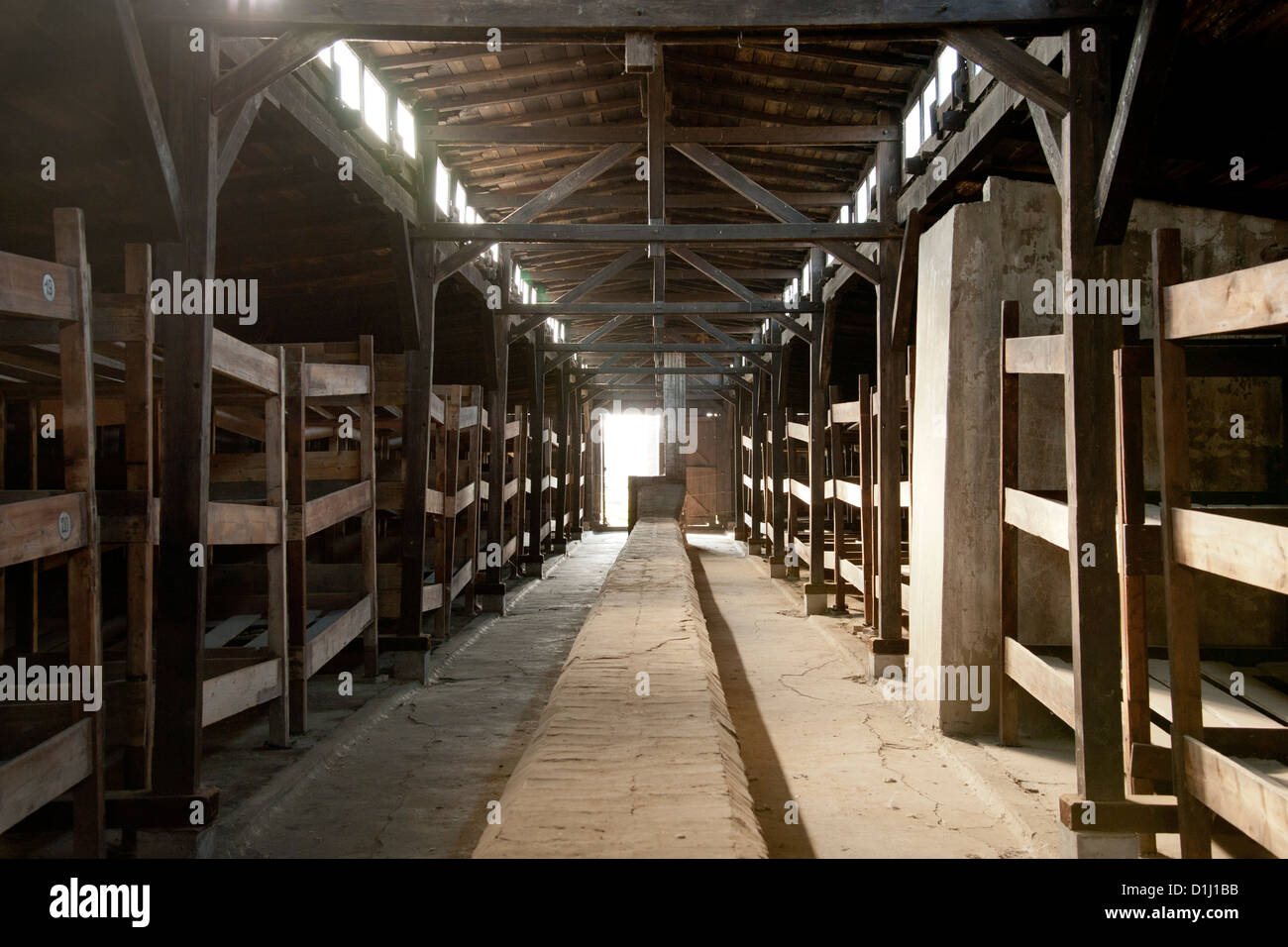 Interior of one of the barracks in the former Auschwitz II–Birkenau concentration camp in southern Poland. - Stock Image