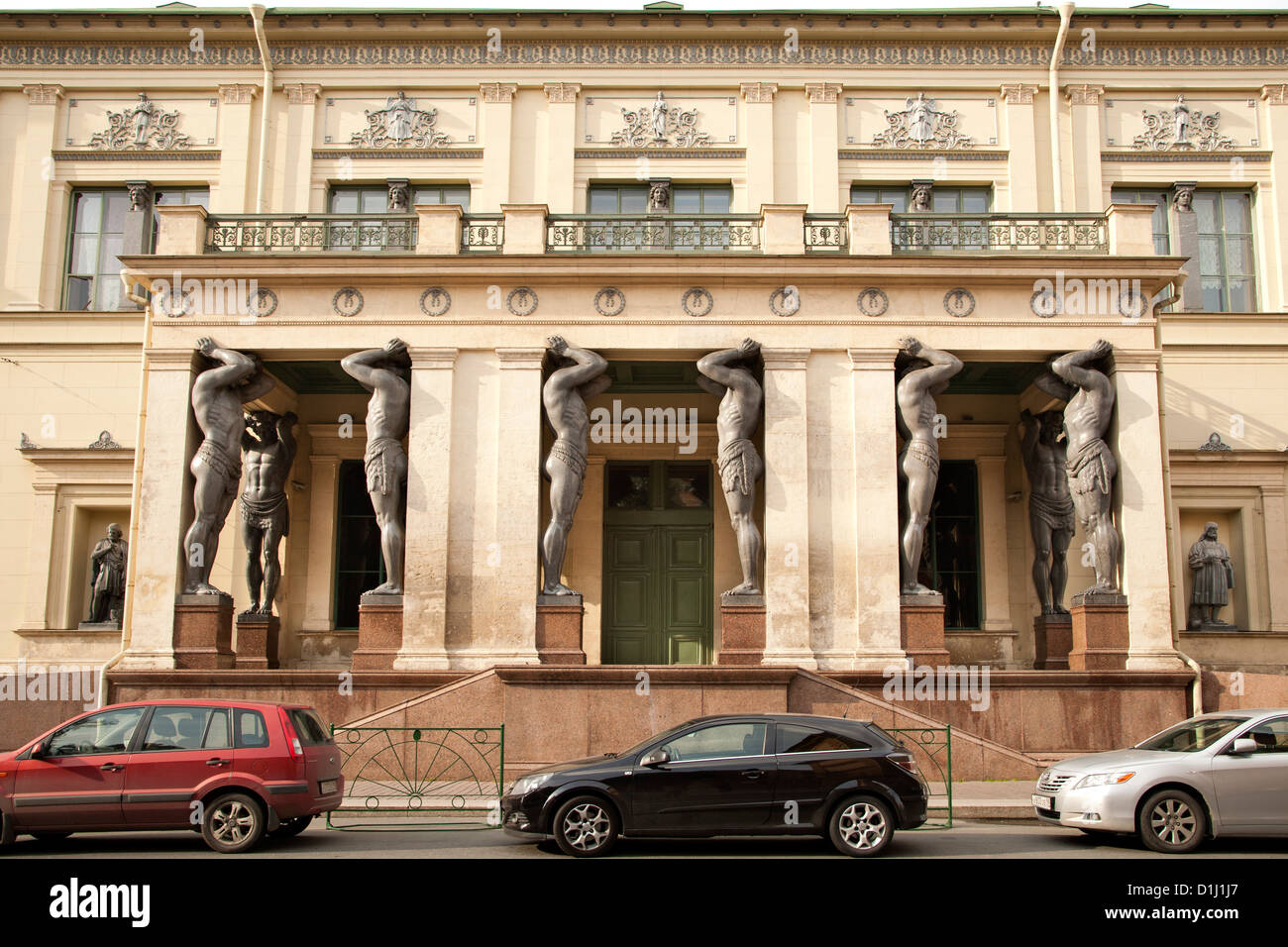 Atlantes statues in the portico of the New Hermitage building in Saint Petersburg, Russia. - Stock Image