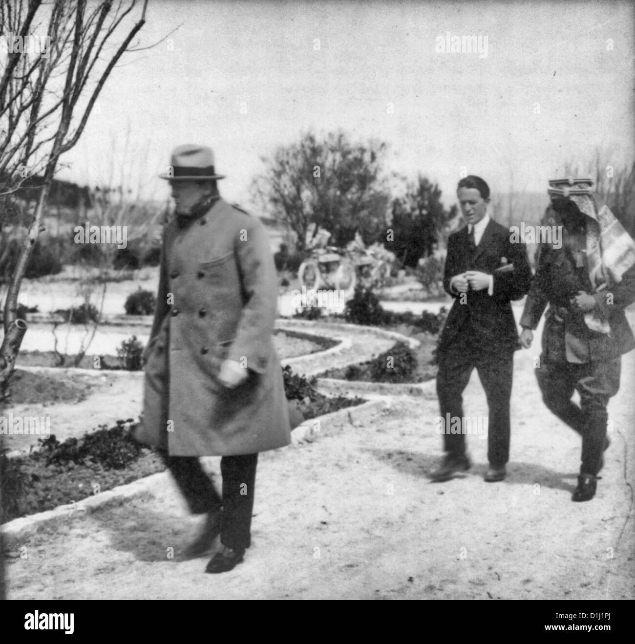 Winston Churchill, 'Lawrence of Arabia,' and Emir Abdullah walking in the gardens of the Government House, - Stock Image