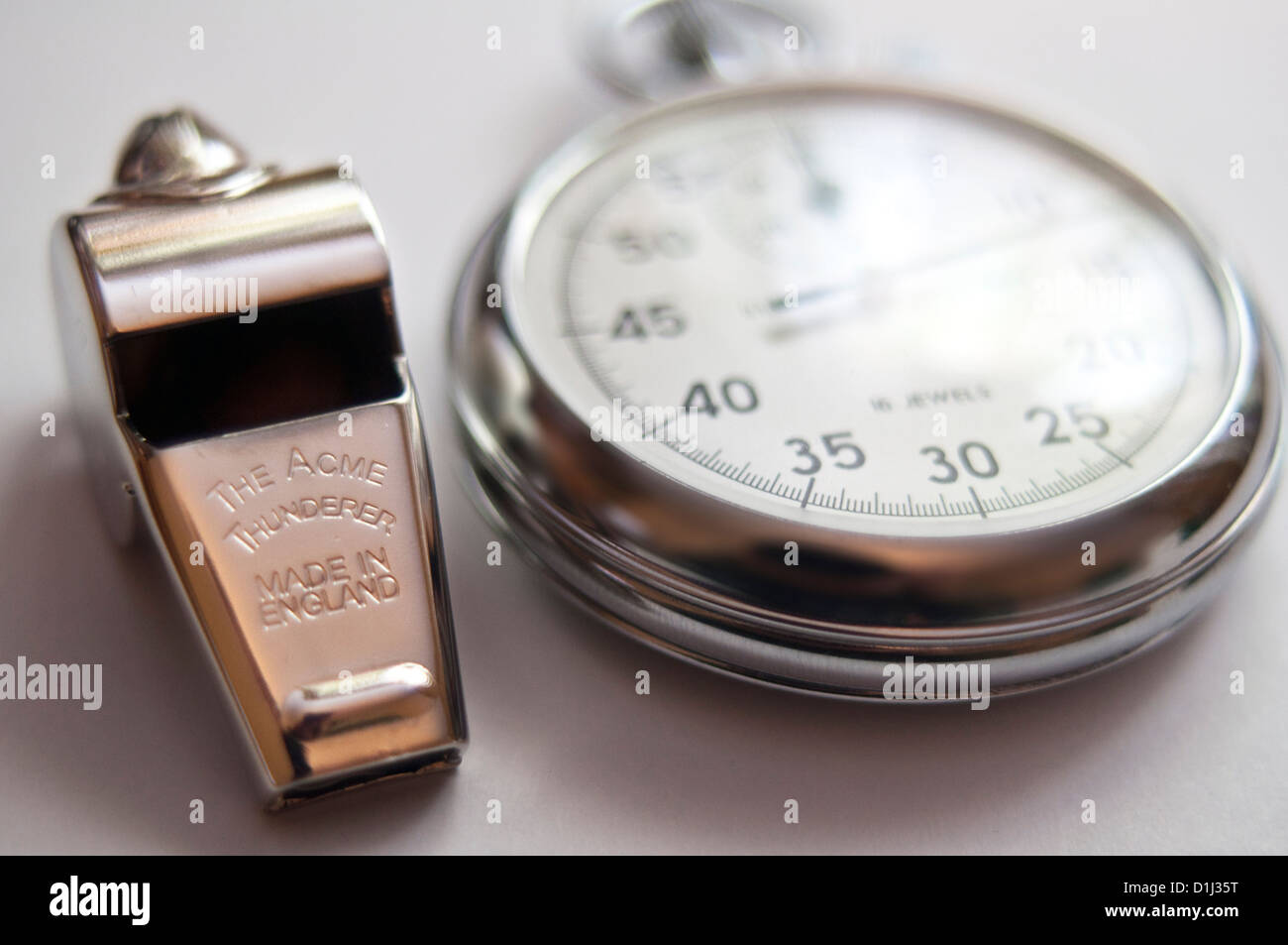 Referees metal whistle The Acme Thunderer and stopwatch - Stock Image