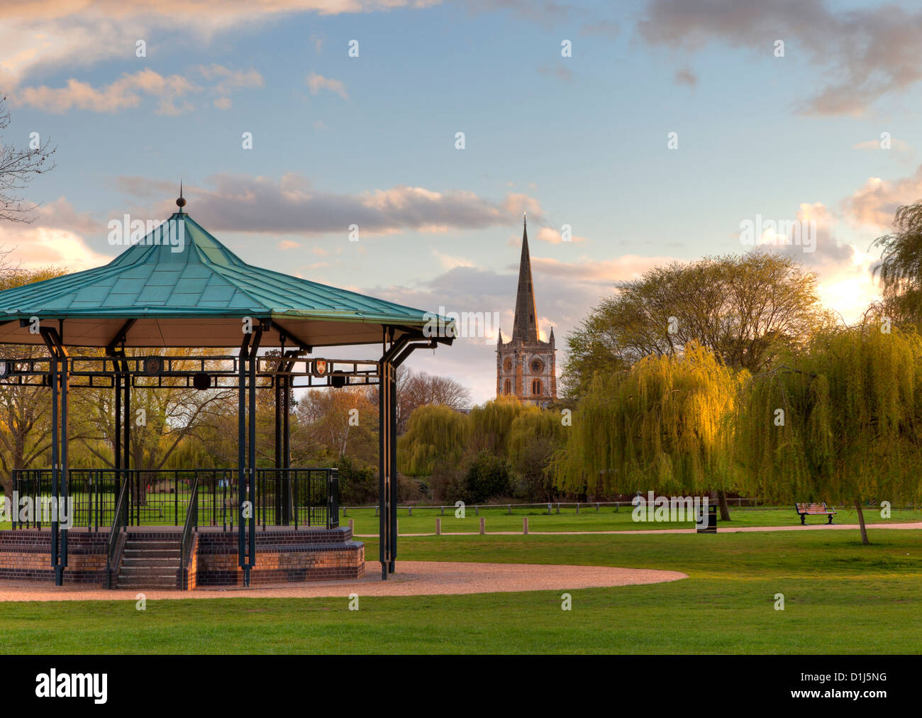 Bandstand and church at Stratford upon Avon, England. - Stock Image