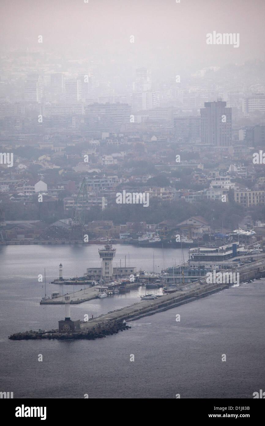 The Black Sea port of Varna, Bulgaria. Fog hangs over the coastal city on a grey and overcast autumn day. - Stock Image