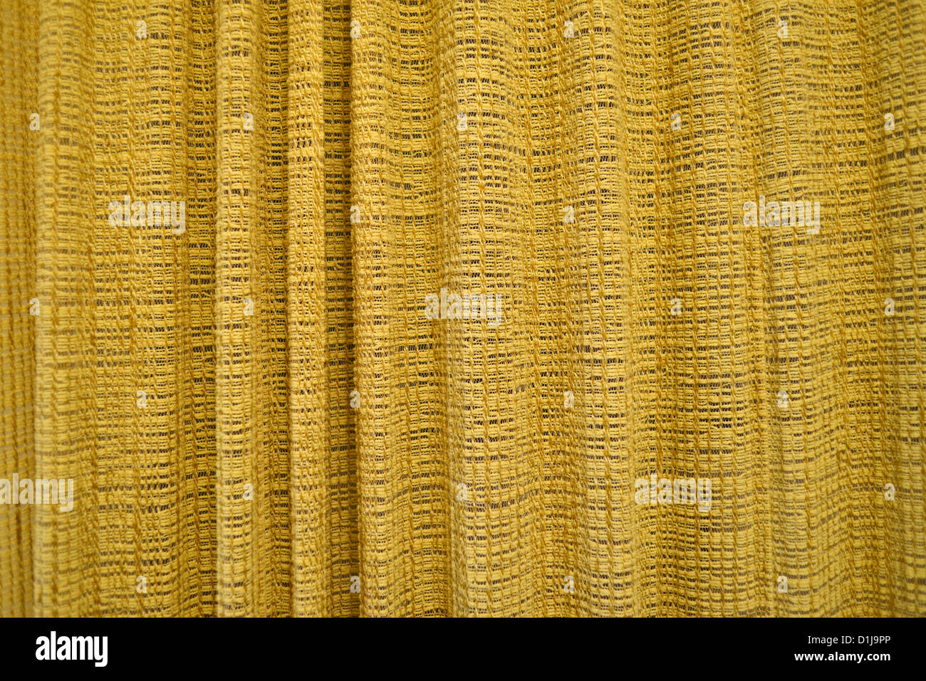 Yellow curtain or drape texture, high resolution and very detailed. Stock Photo