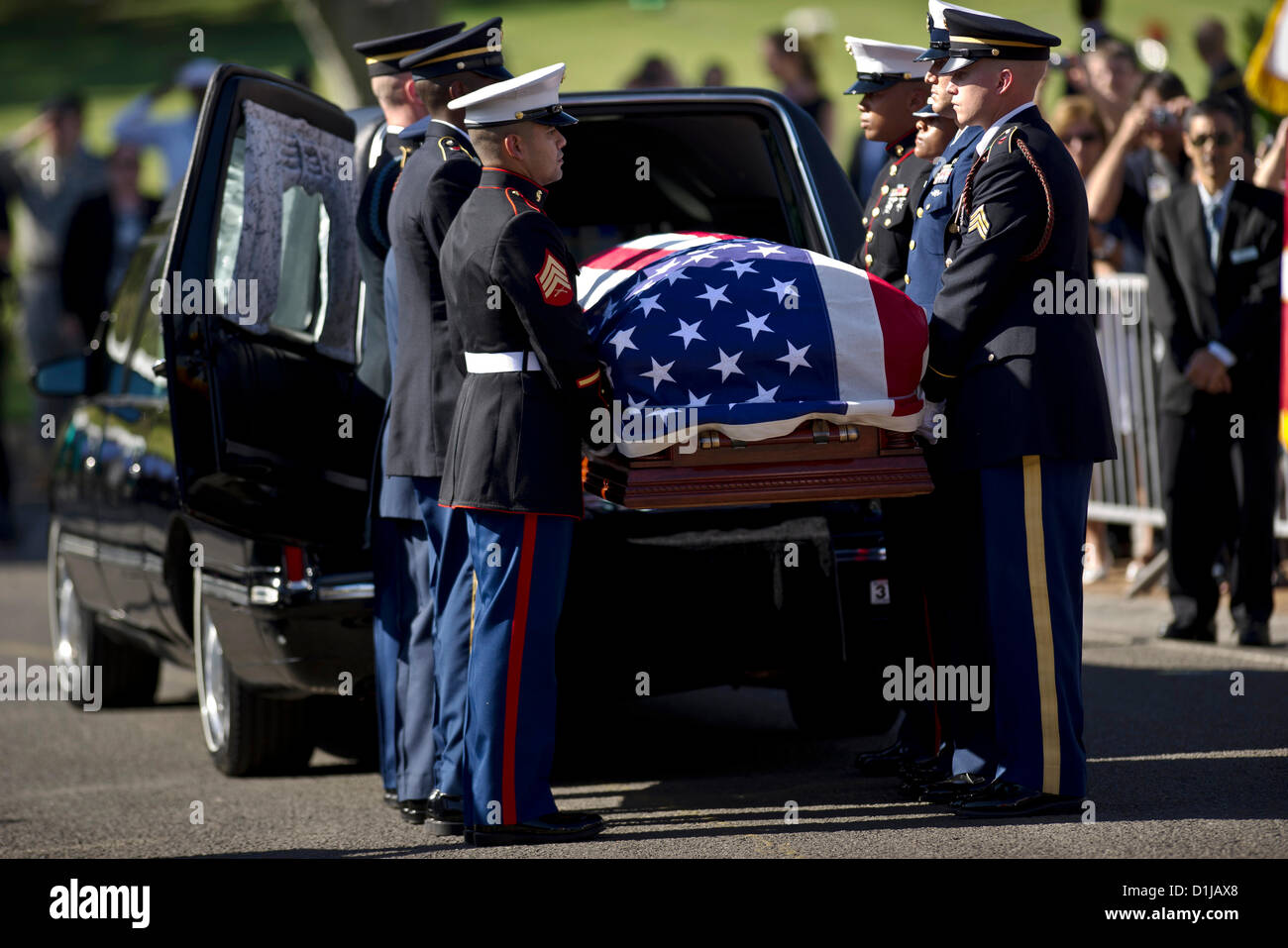Senator Daniel Inouye's flag-draped casket is removed from hearse near the steps of the National Memorial Cemetery - Stock Image