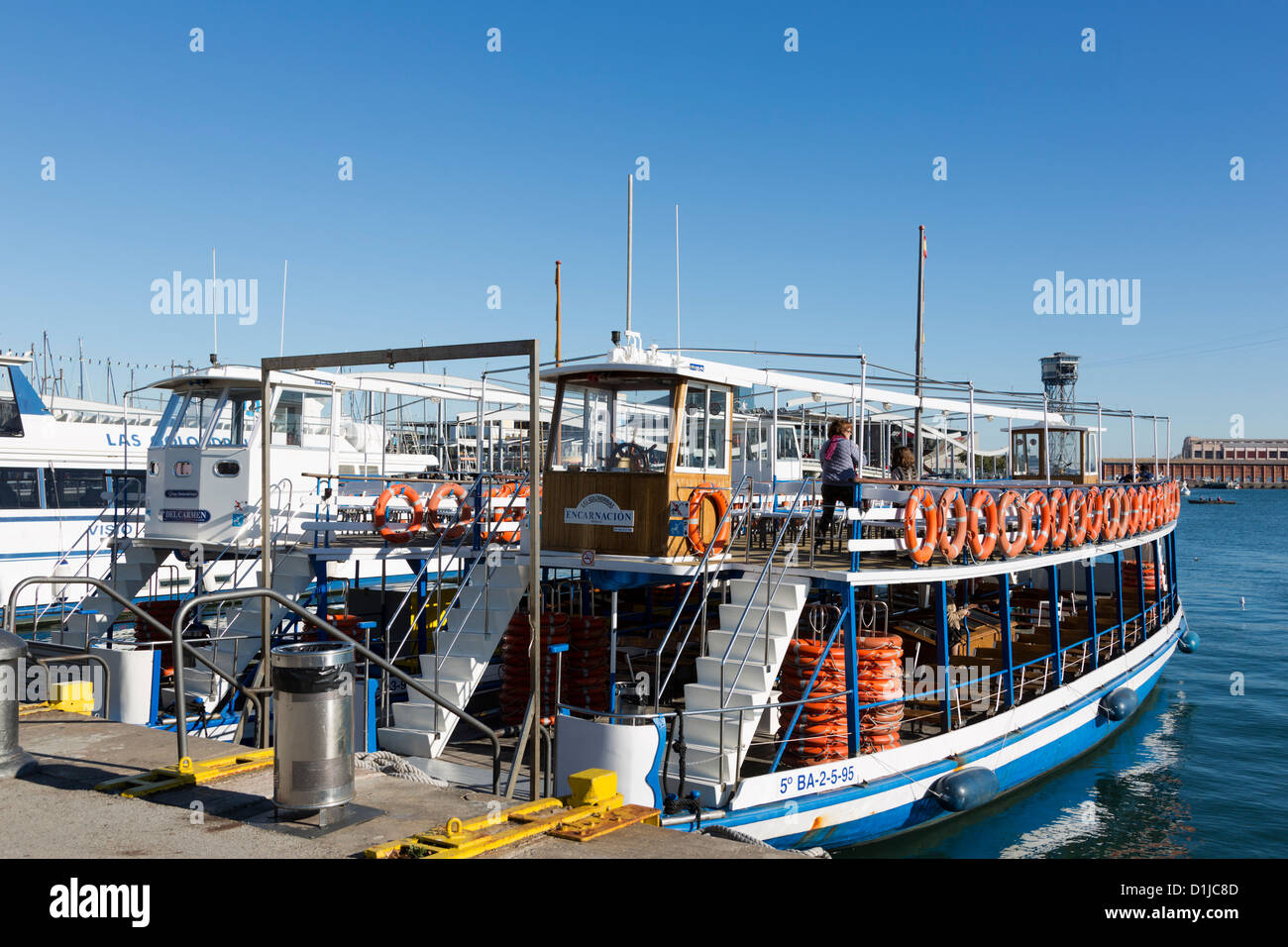 Excursion boat moored in Barcelona's Port Vell - Stock Image