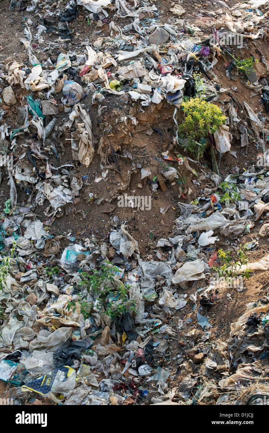 Discarded rubbish with plastic bags in the Indian countryside - Stock Image