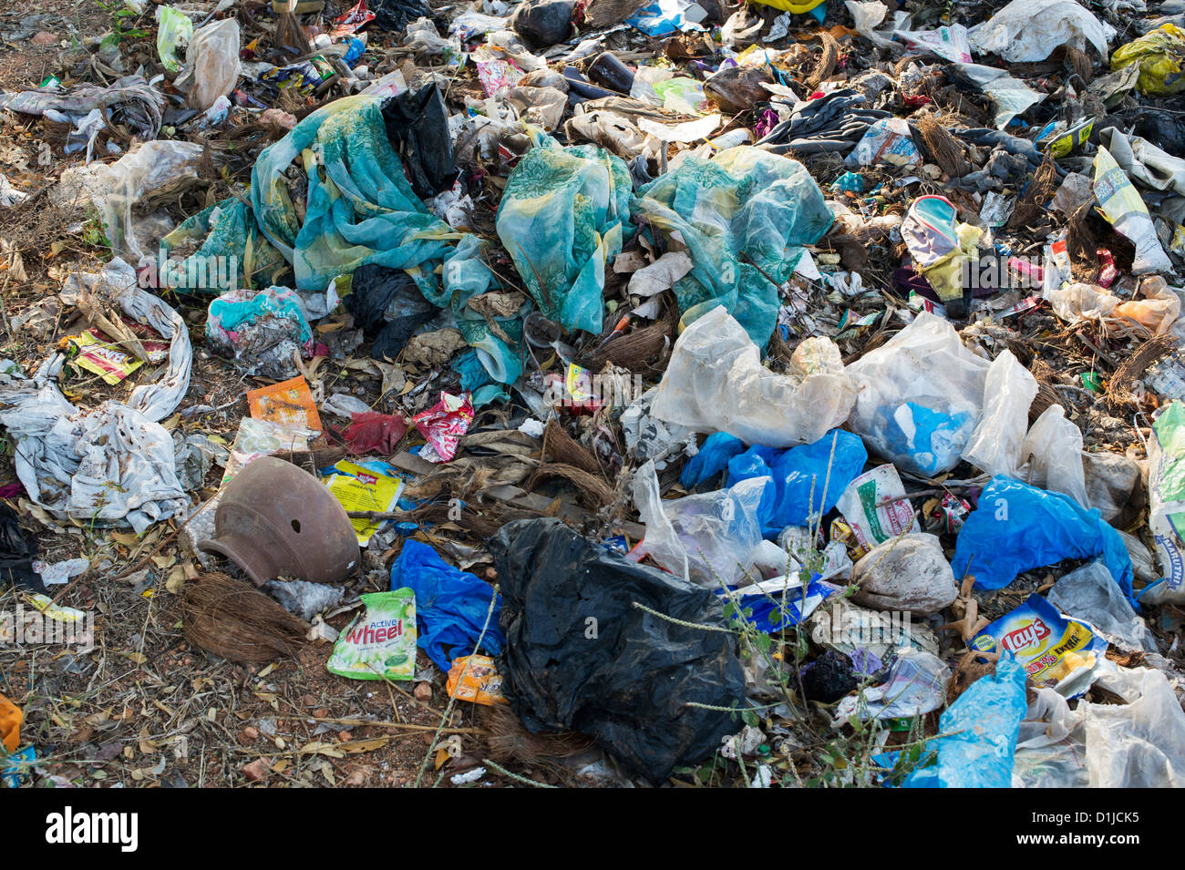 Discarded rubbish with plastic bags in the Indian countryside Stock Photo