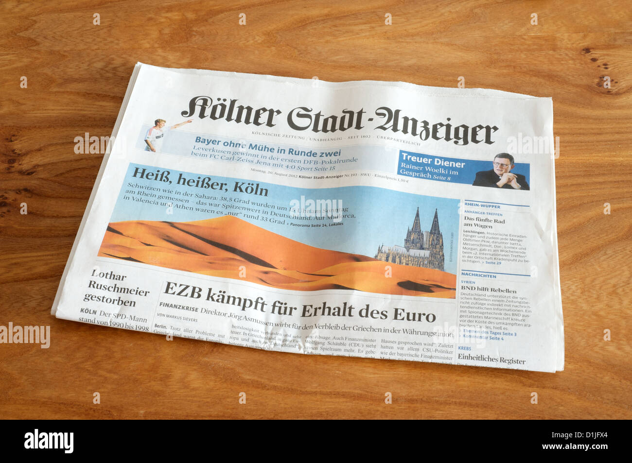 Kolner Stadt Anzeiger with a story of the 2012 summer heat wave in Cologne - Stock Image